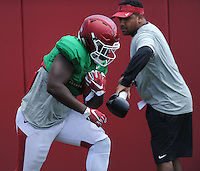 NWA Democrat-Gazette/ANDY SHUPE<br /> Arkansas running back Rawleigh Wiilliams III carries the ball Thursday, Aug. 13, 2015, as running backs coach Jemal Singleton tries to dislodge it during practice at the university practice field in Fayetteville.