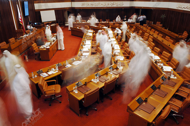 Deputies breaking from a session of the Bahraini parliament, the lower house of the legislative body which is elected, Bahrain, December 12, 2005.