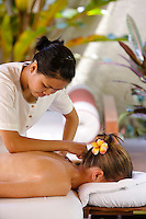 A beauty therapist gives a guest a massage at theMaia Luxury Resort & Spa