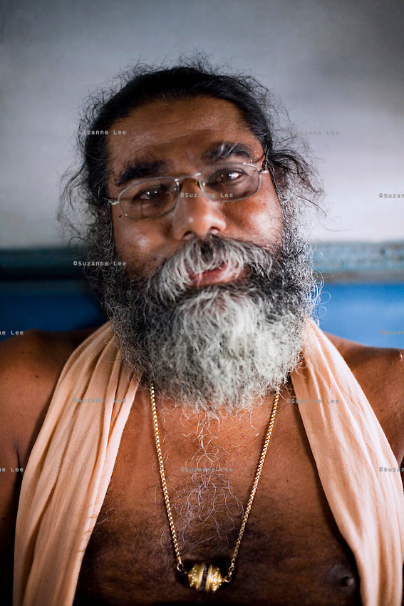 Swamiji K.M. Thangaraju (MBA B.Sc. BL), a retired Inspector of Police, is the leader of the group of 11 traveling swamis returning to Coimbatore after participating in the Amarnath Yatra in Kashmir. ..Train passengers on the Himsagar Express 6318 going from Jammu Tawi station to Kanyakumari on 7th July 2009.. .6318 / Himsagar Express, India's longest single train journey, spanning 3720 kms, going from the mountains (Hima) to the seas (Sagar), from Jammu and Kashmir state of the Indian Himalayas to Kanyakumari, which is the southern most tip of India...Photo by Suzanne Lee / for The National