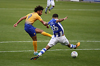 Ryan Inniss of Colchester United tries to block the shot of Lee Angol of Mansfield Town during Colchester United vs Mansfield Town, Sky Bet EFL League 2 Football at the Weston Homes Community Stadium on 7th October 2017