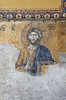 Detail of Deesis mosaic, 12th-13th century, showing Jesus Christ, Hagia Sophia, 532-37, by Isidore of Miletus and Anthemius of Tralles, Istanbul, Turkey. Hagia Sophia, The Church of the Holy Wisdom, has been a  Byzantine church and an Ottoman mosque and is now a museum. The current building, the third on the site, commissioned by Emperor Justinian I, is a very fine example of Byzantine architecture. The historical areas of the city were declared a UNESCO World Heritage Site in 1985. Picture by Manuel Cohen.