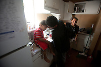 leaving0627 Luis Sanchez Jr (CQ) tries to cheer up his brother Christian Sanchez (CQ) while cooking diner in the family's West Valley home. (Pat Shannahan/ The Arizona Republic)