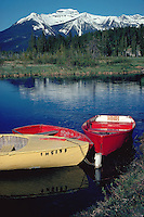Vermilion Lake scene with rowboats and Canadian Rockies