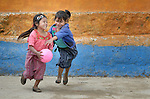 Girls play basketball during a 2014 recess from school in Tuixcajchis, a small Mam-speaking Maya village in Comitancillo, Guatemala. Photo by Paul Jeffrey.