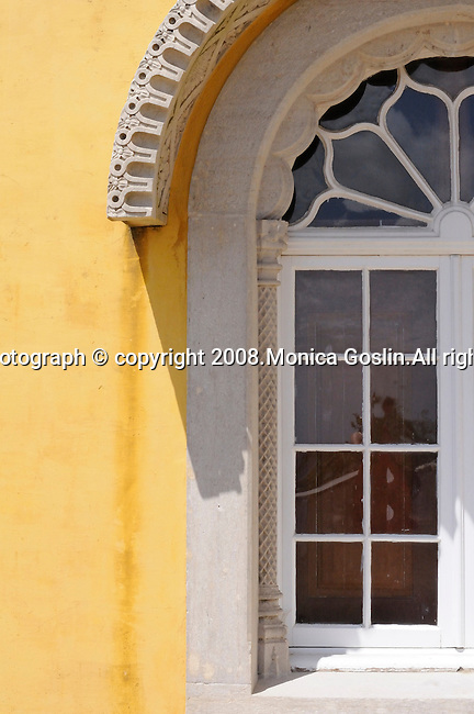 A yellow window at the Pena National Palace in Sintra, Portugal.