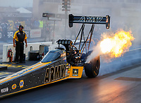 Jul 21, 2017; Morrison, CO, USA; AFlames come from the exhaust header pipes from the engine on the dragster of NHRA top fuel driver Tony Schumacher during qualifying for the Mile High Nationals at Bandimere Speedway. Mandatory Credit: Mark J. Rebilas-USA TODAY Sports