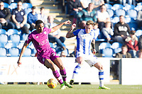 Sammie Szmodics of Colchester United defends from the front and prevents Kelvin Etuhu of Carlisle United from clearing during Colchester United vs Carlisle United, Sky Bet EFL League 2 Football at the JobServe Community Stadium on 23rd February 2019