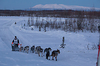 Benjamin Harper on the trail approaching the finish line of the 2014 Jr. Iditarod Sled Dog Race at Happy Trails Kennel, Big Lake, Alaska<br /> Sunday February 23, 2014 <br /> <br /> Junior Iditarod Sled Dog Race 2014<br /> PHOTO BY JEFF SCHULTZ/IDITARODPHOTOS.COM  USE ONLY WITH PERMISSION