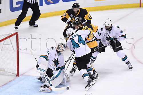 30.05.2016. Pittsburgh, PENN, USA.  San Jose Sharks goalie Martin Jones (31) makes a save with Pittsburgh Penguins left wing Carl Hagelin (62) in front and San Jose Sharks defenseman Marc-Edouard Vlasic (44) defending during the second period of Game One in the 2016 NHL Stanley Cup Final between the San Jose Sharks and the Pittsburgh Penguins at the Consol Energy Center in Pittsburgh, Pennsylvania.   The Penguins scores late in the game for a 3-2 home win.