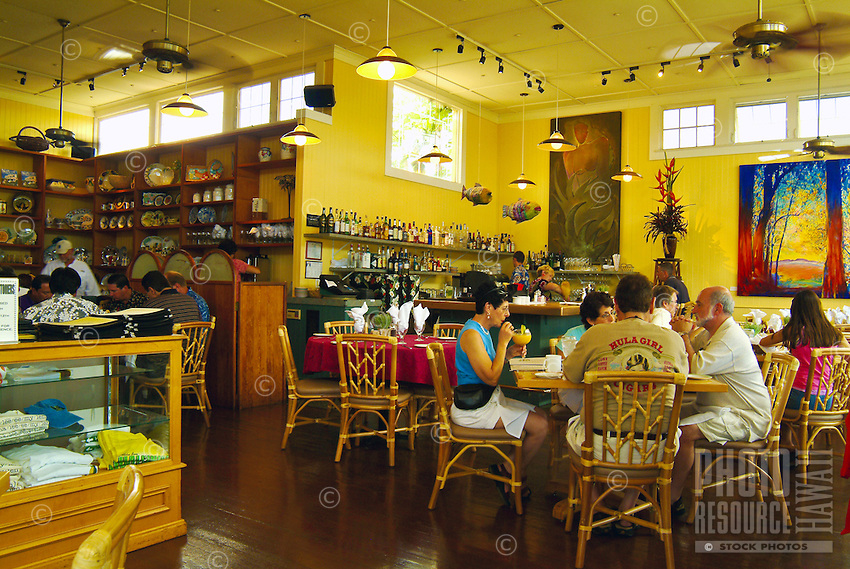 Guests sit on bamboo-style chairs to dine at Chef Beverly Gannon's Hali'imaile Restaurant on the slopes of dormant Haleakala volcano in Upcountry Maui, where art decorates the walls and handpainted dishes and other crafts and souvenirs are for sale.