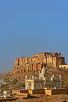 The Jaswant Thada mausoleum and Mehrangarh Fort, Jodhpur, India.  It is a white marble memorial built by Sardar Singh in 1899 in memory of Maharja Jaswant Singh II. The monument, in its entirety, is built out of intricately carved sheets of marble.