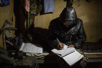 The responsible of the logistic of the Mohammed Said checkpoint notes what they need from the main base of Kunar, Afghanistan, 15th November 2017. <br /> <br /> Le responsable de la logistique du point avancé Mohammed Said note ce dont ils ont besoin comme ravitaillement venant de la base principale de Kunar, Afghanistan, le 15 novembre 2017.