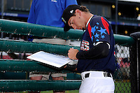 Kane County Cougars outfielder Albert Almora #2 signs autographs before a game against the Beloit Snappers on May 26, 2013 at Fifth Third Bank Ballpark in Geneva, Illinois.  Beloit defeated Kane County 6-5.  (Mike Janes/Four Seam Images)