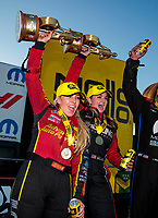 Nov 3, 2019; Las Vegas, NV, USA; NHRA top fuel driver Brittany Force (left) and pro stock driver Erica Enders celebrate after winning the Dodge Nationals at The Strip at Las Vegas Motor Speedway. Mandatory Credit: Mark J. Rebilas-USA TODAY Sports
