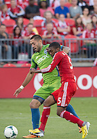August 10, 2013: Seattle Sounders FC forward Clint Dempsey #2 and Toronto FC defender Ashtone Morgan #5 in action during an MLS regular season game between the Seattle Sounders and Toronto FC at BMO Field in Toronto, Ontario Canada.