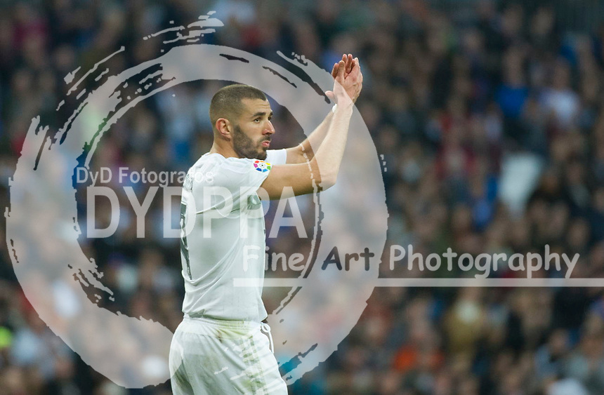 Real Madrid's French forward Karim Benzema greets supporters after been changed