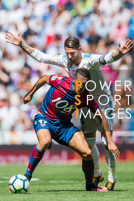 Alexander Alegria Moreno of Levante UD (front) fights for the ball with Sergio Ramos of Real Madrid (back) during the La Liga match between Real Madrid and Levante UD at the Estadio Santiago Bernabeu on 09 September 2017 in Madrid, Spain. Photo by Diego Gonzalez / Power Sport Images