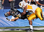 Wyoming defender Ghaali Muhammad (23) pushes Nevada's Kendall Brock (20) out of bounds as he dives for the end zone during the first half of an NCAA college football game in Reno, Nev., on Saturday, Oct. 6, 2012. (AP Photo/Cathleen Allison)
