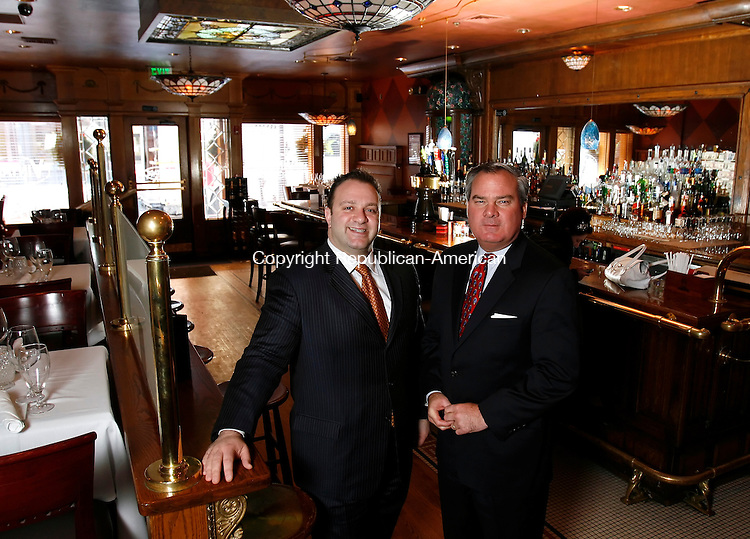 WATERBURY, CT, 02/04/08- 020409BZ09- Vasilias Kaloidis, owner/partner of Vintage Restaurant on Bank Street in Waterbury, and John G. Rowland, economic development director for the City of Waterbury, pose in the bar area of Vintage Restaurant Wednesday. <br /> Jamison C. Bazinet Republican-American