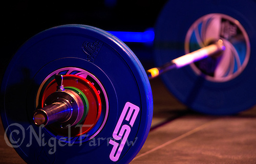 10 MAY 2014 - COVENTRY, GBR - A barbell stands on the platform ready for the next lifter at the British 2014 Senior Weightlifting Championships and final 2014 Commonwealth Games qualifying event round at the Ricoh Arena in Coventry, Great Britain (PHOTO COPYRIGHT © 2014 NIGEL FARROW, ALL RIGHTS RESERVED)