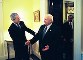 United States President George W. Bush welcomes Prime Minister Ariel Sharon of Israel to the White House Wednesday, April 14, 2004. The two leaders met in the residence before holding a joint press conference. Pictured behind the Prime Minister is United States Department of State Chief of Protocol Donald Ensenat. <br /> Mandatory Credit: Eric Draper - White House via CNP