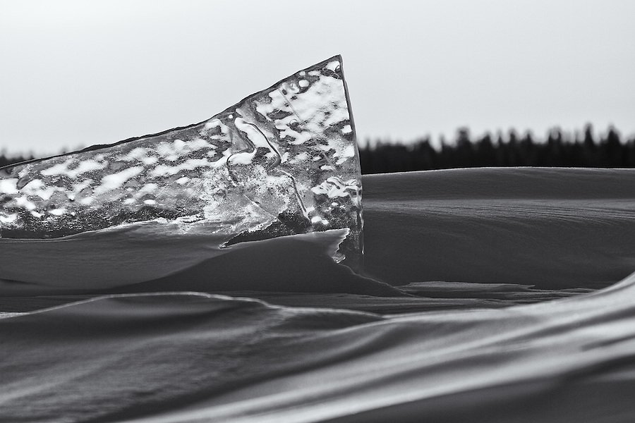 A sharp and translucent fragment of ice sticks up from the frozen snow crust of Great Slave Lake in Canada's Northwest Territories during mid-January.