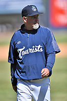 Asheville Tourists pitching coach Mark Brewer (13) walks back to the dugout after a mound visit during a game against the Delmarva Shorebirds at McCormick Field on May 5, 2019 in Asheville, North Carolina. The Shorebirds defeated the Tourists 10-9. (Tony Farlow/Four Seam Images)
