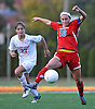 St. John the Baptist No. 10 Bridget Patch, right, settles a ball as Sacred Heart No. 27 Christina Biscardi pressures her during a CHSAA varsity girls' soccer game at Sacred Heart Academy on Monday, October 5, 2015. Sacred Heart won by a score of 3-1.<br /> <br /> James Escher