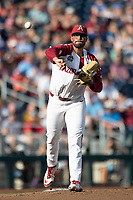 Arkansas Razorbacks pitcher Isaiah Campbell (55) makes a throw to first base during Game 2 of the NCAA College World Series against the Florida State Seminoles on June 15, 2019 at TD Ameritrade Park in Omaha, Nebraska. Florida State defeated Arkansas 1-0. (Andrew Woolley/Four Seam Images)