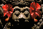 Temple Figure, Sanur, Bali, Indonesia, Asia, photo bali219, Photo Copyright:  Lee Foster, www.fostertravel.com, 510-549-2202, lee@fostertravel.com, temple figure, figurine, icon, statue, figurehead, flora, flower, horizontal