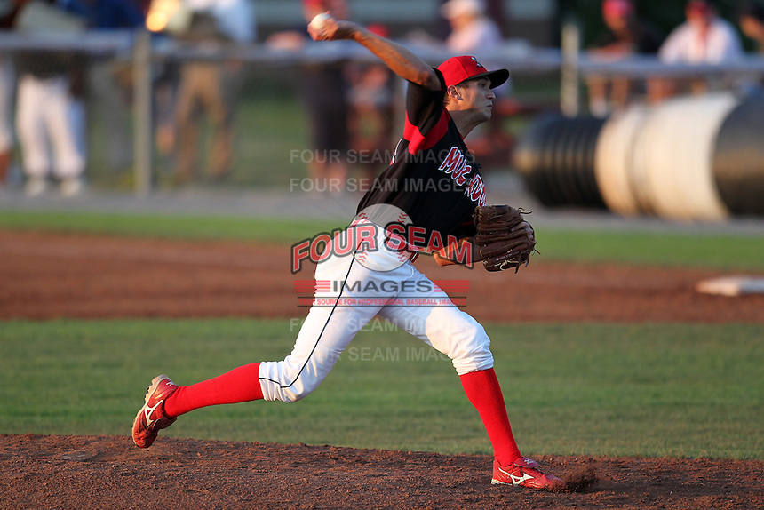 Batavia Muckdogs pitcher Chris Corrigan (16) delivers a pitch during a game vs. the Lowell Spinners at Dwyer Stadium in Batavia, New York July 16, 2010.   Batavia defeated Lowell 5-4 with a walk off RBI single in the bottom of the 9th inning.  Photo By Mike Janes/Four Seam Images
