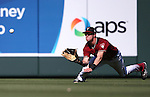 Diamondbacks&rsquo; Evan Marzilli makes a diving catch during a spring training game against the Dodgers in Scottsdale, Ariz., on Friday, March 18, 2016. The Diamondbacks won 11-8.<br />Photo by Cathleen Allison