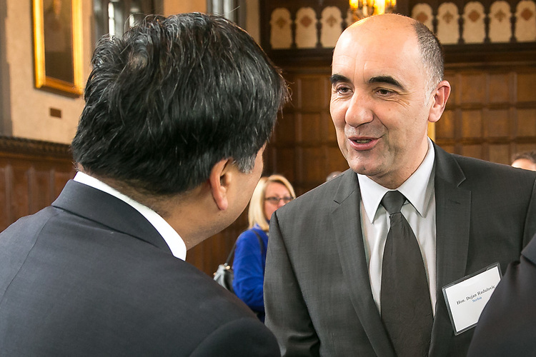 Dejan Radulović, acting consul general of the Republic of Serbia, meets A. Gabriel Esteban, Ph.D., president of DePaul University, as guests gather in Cortelyou Commons for the 13th Annual Consular Corps Luncheon, Tuesday, April 3, 2018, on DePaul's Lincoln Park Campus. The event brings together members of the international consulate community with university staff and faculty in an effort to promote partnerships and educational programs. (DePaul University/Jamie Moncrief)
