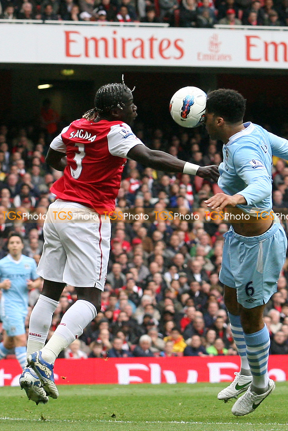 Bacary Sagna of Arsenal and Joleon Lescott of Manchester City -  Arsenal - Manchester City at the Emirates Stadium - 08/04/12 - MANDATORY CREDIT: Dave Simpson/TGSPHOTO - Self billing applies where appropriate - 0845 094 6026 - contact@tgsphoto.co.uk - NO UNPAID USE.