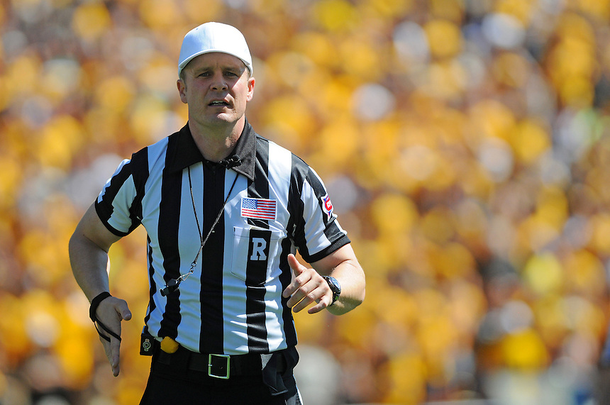SEPTEMBER 10 2011: A referee   during a non-conference game with two PAC 12 teams between the Californa Golden Bears and the University of Colorado Buffaloes at Folsom Field in Boulder, Colorado. The Golden Bears beat the Buffaloes 36-33 in overtime.  *****For editorial use only*****