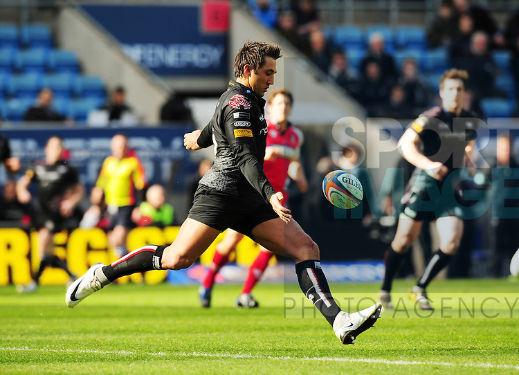 Gavin Henson of Ospreys clears the ball out of the 22