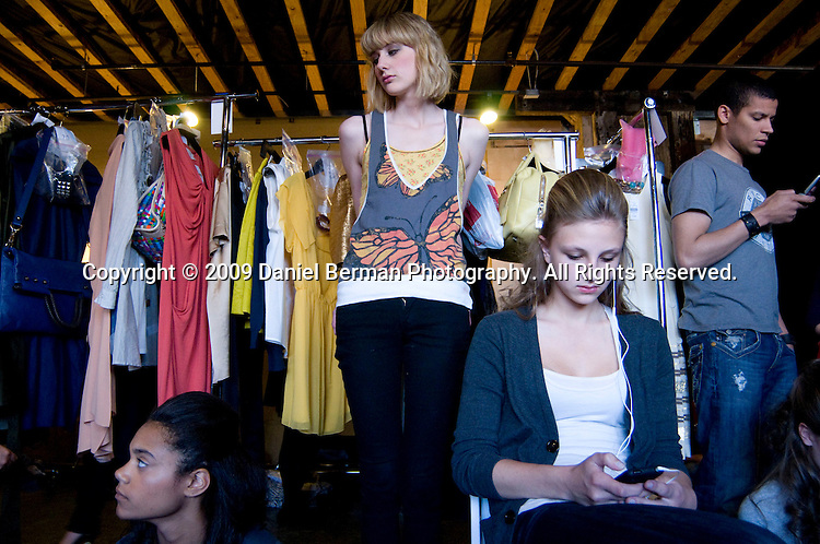 Clockwise from bottom-left, Models Jordan Greene, Hayley Oberbillig, Tristyn Rowlan, and Michaela Boyce take some time to relax during the FACE fashion show in Seattle Thursday April 30, 2009 at Herban Feast to raise money for Sunflower Children's fund. Photo by Daniel Berman/SeattlePI.com