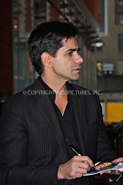 WWW.ACEPIXS.COM . . . . .  ....October 21, 2009, New York City.....Actor John Stamos leaves the 'Bye Bye Birdie' Musical held at the Henry Miller's Theatre on October 21, 2009 in New York City.....He plays Albert Peterson in the musical.......Please byline: Joanne Juele - ACEPIXS.COM.... *** ***..Ace Pictures, Inc:  ..Philip Vaughan (646) 769 0430..e-mail: info@acepixs.com..web: http://www.acepixs.com
