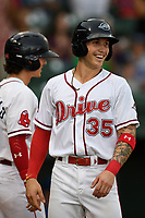 Right fielder Jarren Duran (35) of the Greenville Drive is greeted after scoring a run during a game against the Lexington Legends on Sunday, September 2, 2018, at Fluor Field at the West End in Greenville, South Carolina. Greenville won, 7-4. (Tom Priddy/Four Seam Images)
