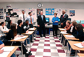 "United States President George W. Bush answers a teacher's question about government to an advanced placement (AP) Government class during a visit to J.E.B. Stuart High School in Falls Church, Virginia on January 12, 2005.  With the President are first lady Laura Bush and United States Secretary of Education Rod Paige.  President Bush visited the classroom following his remarks on expanding the ""No Child Left Behind"" program. <br /> Credit: Ron Sachs / Pool via CNP"