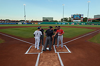 Bowling Green Hot Rods manager Craig Albernaz (1) meets with Peoria Chiefs manager Chris Swauger (8) and umpires Steven Jaschinski, Steven Hodgins, Harrison Silverman and Chris Presley-Murphy before a game against the Peoria Chiefs on September 15, 2018 at Bowling Green Ballpark in Bowling Green, Kentucky.  Bowling Green defeated Peoria 6-1.  (Mike Janes/Four Seam Images)