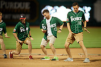 The Fort Wayne TinCaps grounds crew dancing during a game against the West Michigan Whitecaps on May 17, 2018 at Parkview Field in Fort Wayne, Indiana.  Fort Wayne defeated West Michigan 7-3.  (Mike Janes/Four Seam Images)