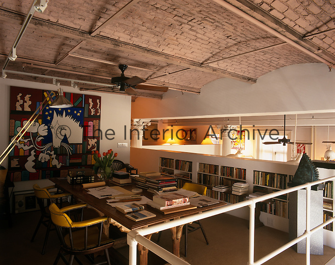 A home office has been created on the mezzanine floor of this converted warehouse