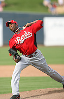 Aroldis Chapman #54 of the Cincinnati Reds pitches in a spring training game against the Milwaukee Brewers at Maryvale Stadium on March 20, 2011  in Phoenix, Arizona. .Photo by:  Bill Mitchell/Four Seam Images.