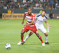 CARSON, CA – NOVEMBER 14: FC Dallas forward Atiba Harris (16) and LA Galaxy defender Omar Gonzalez (4) during the Western Conference Final soccer match at the Home Depot Center, November 14, 2010 in Carson, California. Final score LA Galaxy 0, Dallas FC 3.
