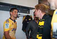 Otere Black meets Prince Harry in the changing rooms after the Super Rugby match between the Hurricanes and Sharks at Westpac Stadium, Wellington, New Zealand on Saturday, 9 May 2015. Photo: Dave Lintott / lintottphoto.co.nz