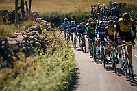 Team LottoNL-Jumbo bringing GC leader Primoz Roglic (SVK/LottoNL-Jumbo) back to the peloton after he was involved in a minor crash<br /> <br /> Racing in/around Lake District National Parc / Cumbria<br /> <br /> Stage 6: Barrow-in-Furness to Whinlatter Pass   (168km)<br /> 15th Ovo Energy Tour of Britain 2018