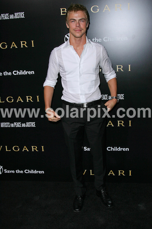 **ALL ROUND PICTURES FROM SOLARPIX.COM**                                             **SYNDICATION RIGHTS FOR UK, AUSTRALIA, DENMARK, PORTUGAL, S. AFRICA, SPAIN & DUBAI (U.A.E) & ASIA (EXCLUDING JAPAN) ONLY**                                                                                  Caption:  Arrivals at the Bvlgari Private Event honouring Simon Fuller and Paul Haggis to Benefit Save the Children and Artists for Peace and Justice, held at the Ron Burkle Residence, Beverly Hills, USA. 13 January 2011                                                                    This pic: Derek Hough                                                                    JOB REF: 12666 PHZ Charlotte      DATE: 13_01_2011                                                           **MUST CREDIT SOLARPIX.COM OR DOUBLE FEE WILL BE CHARGED**                                                                      **MUST AGREE FEE BEFORE ONLINE USAGE**                               **CALL US ON: +34 952 811 768 or LOW RATE FROM UK 0844 617 7637**