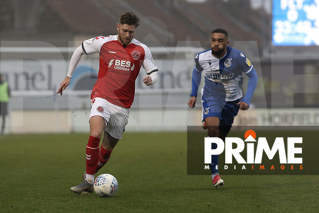 Wes Burns of Fleetwood Town leaves Tareiq Holmes-Dennis of Bristol Rovers behind during the Sky Bet League 1 match between Bristol Rovers and Fleetwood Town at the Memorial Stadium, Bristol, England on 25 January 2020. Photo by Dave Peters / PRiME Media Images.
